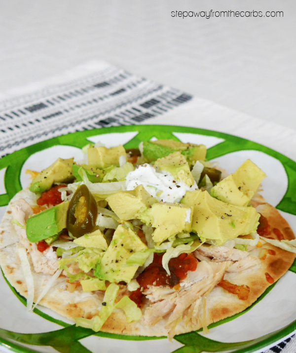 Low Carb Chicken Tostadas - a crispy tortilla loaded with chicken, cheese, salsa, avocado, and more!