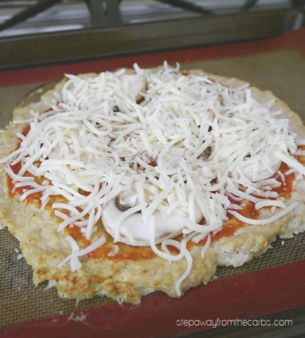 Low Carb Chicken Meatza Pizza - with a seasoned chicken crust! Gluten free, LCHF and keto friendly recipe.