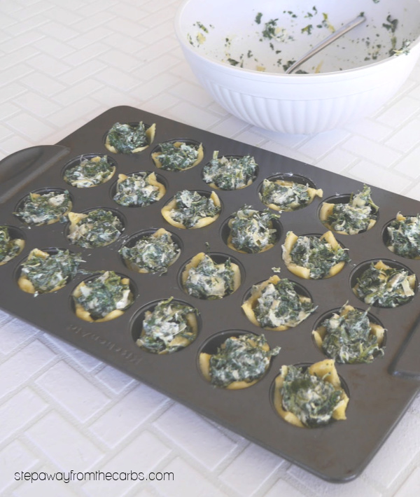 Low Carb Spinach Dip Bites - tasty little morsels made with Fathead dough, spinach, and artichoke!