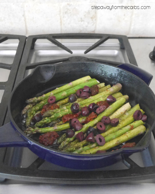 10-Minute Sautéed Asparagus - a low carb side dish recipe with sun-dried tomatoes, olives, and basil.