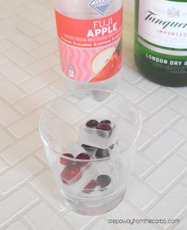 Low Carb Apple Cocktail - a gin based drink with cranberry ice cubes that is sugar free and keto friendly.
