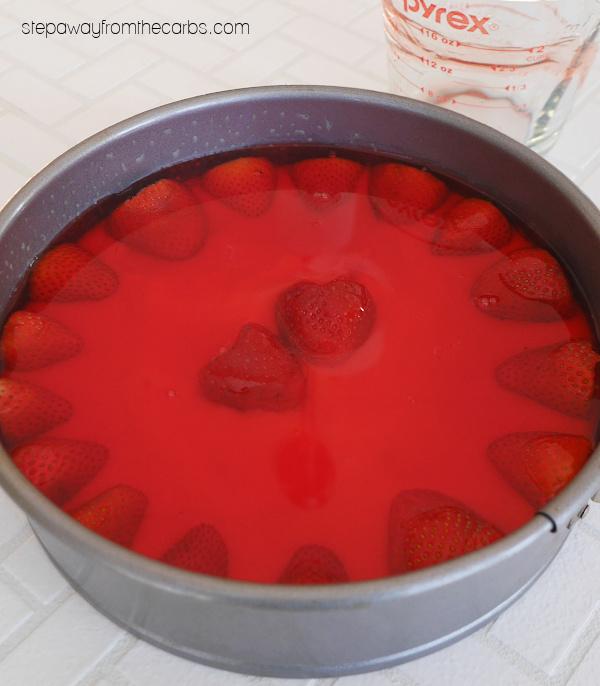 Keto Strawberry Jel Cake - a nutty base, then a layer of strawberry vanilla pudding, finished with strawberry jel