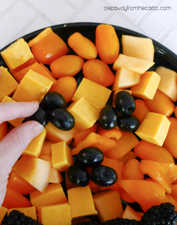 Keto Halloween Snack Tray - a delicious combination of orange and black low carb snack foods!